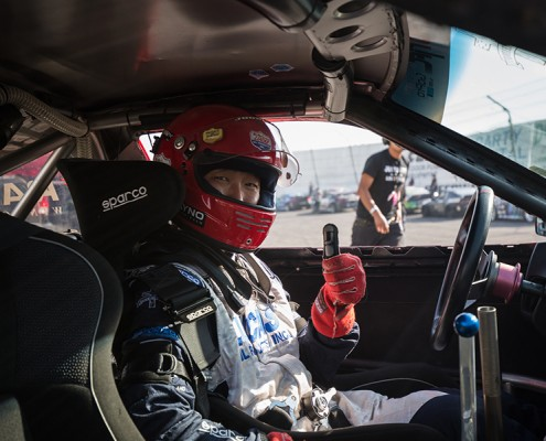 Joon Maeng gives a thumbs-up in his vehicle at the Formula Drift season Finale