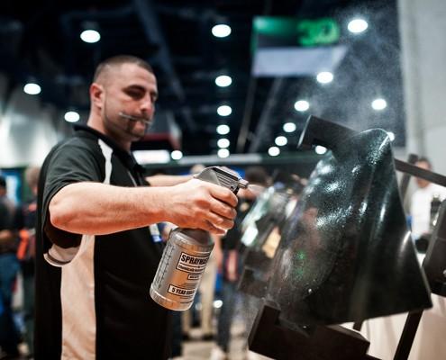 man spraying car par