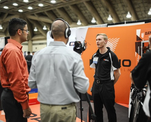 A Rayno employee is being interviewed at the International 2015 Window Film Conference.