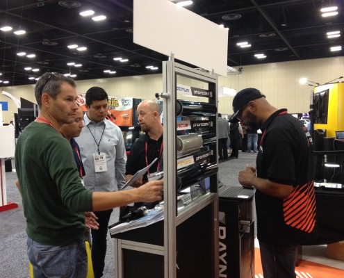 men looking at window film samples