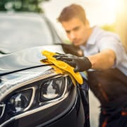 man cleaning and protecting car paint